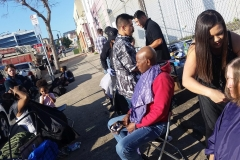 Tammy and the team cutting the homeless hair on the streets of San Diego downtown