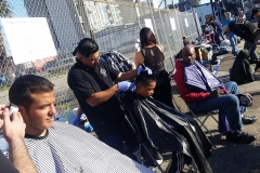 Homeless haircuts on the streets of downtown San Diego.