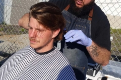 Our homeless friend Gordy getting his hair cut.