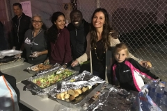Christina, Venice, Conrad, Marta and little Aryana serving the homeless food in the food line.