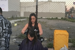 Tammy hard at work cutting a homeless lady's hair