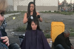 Tammy cuts a homeless women's hair at our homeless special event.