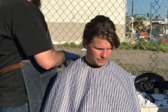 Eric finishes up Gordy's hair cut at our homeless San Diego hair cutting event