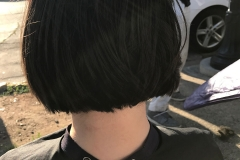 The back of Angel's head as Tammy cuts her hair