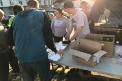 Feeding the homeless some appetizers before the big meal is served