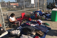 Some of the clothing being set up for San Diego's homeless