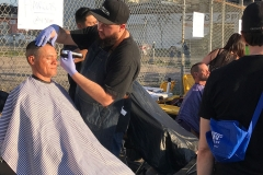 Eric from the Country Club Barber Shop cuts a homeless man's hair