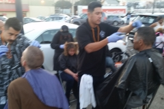 Mario and Jose from the Country Club Barber Shop give San Diego's homeless a professional haircut!
