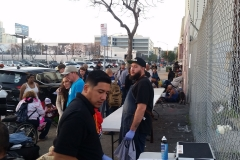 With the haircut team done for the night, the food line tables are being set up to feed the homeless.