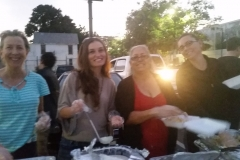Karen, Marta, Christina and Tammany are all smiles while serving food to the homeless in San Diego.