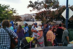 San Diego's homeless start lining up for a meal to be served.