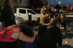 Tammy hugging a homeless woman after she cut her hair.