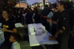 Volunteer Nate helping prepare food trays to feed San Diego's homeless.