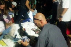 Volunteer Curtis going through toiletries for the homeless.