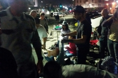 Passing out clothing donations and shoes to San Diego's homeless.