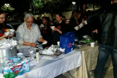 Tammy, Christina, Jenn and others passing out hot food and hot drinks to San Diego's homeless at our Thanksgiving event.