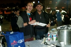 Nate and Eric preparing food plates for the homeless at our Thanksgiving event.
