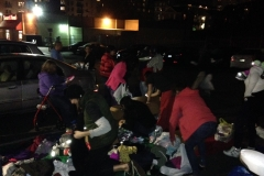 Passing out clothing and other donations at the Streets of Hope San Diego Homeless Thanksgiving event.