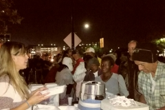 Suzy passing out food plates to San Diego's homeless for Thanksgiving.