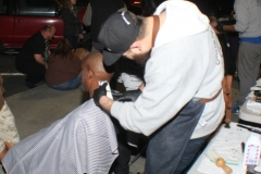 Getting a professional haircut for the homeless on the streets of San Diego.