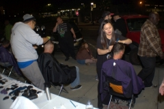 Tammy gives a homless man a haircut on the Streets of Hope special event.