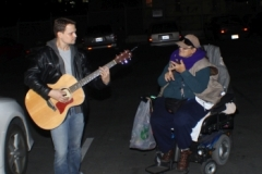 Chris sings a worship song as homeless woman Dorthy sings along.