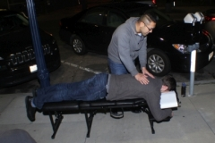 Dr Jeremy gives a professional chiropractic session to a homeless man.