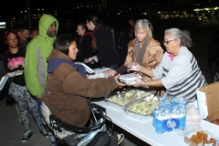 Christina and Michelle pass out food to the homeless on the streets.
