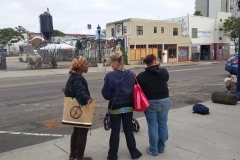Some homeless women waiting for a haircut on the streets in downtown San Diego.