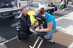 David massages a homeless women's back at the Streets of Hope Easter Event