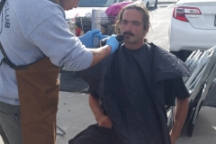 Homeless man gets his goatee cut on Easter