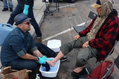 Washing a homeless man's feet at our Easter event in downtown San Diego