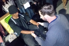 Dr. Eric gives a homeless man a chiropractic adjustment at our Easter event
