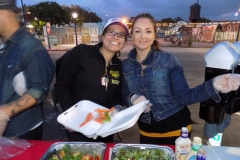 Happily passing out food to San Diego's homeless downtown for Easter.