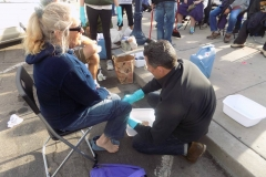 Washing the feet of a homeless women for Easter on the streets of San Diego.