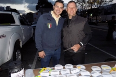Carlos and David at the Lids of Encouragement table for the homeless.