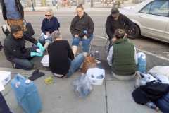 The homeless feet washing team is hard at work washing feet!