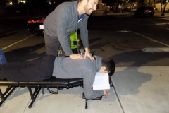 Dr. Eric does another adjustment on the Streets of San Diego