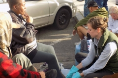 Anne washes a homeless women's feet on Easter