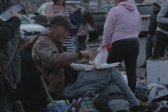 A downtown San Diego homeless man eats at our Streets of Hope event on Easter.