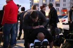 Dr. Eric gives a professional chiropractic adjustment to a homeless man on Easter.