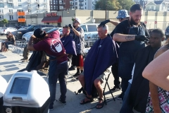 The incredible men of the Country Club Barber Shop cutting the hair of the homeless downtown.