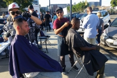 Mario and Wylie cut the homeless' hair downtown.