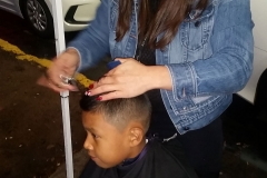 Cutting a little boy's hair at our downtown San Diego homeless Thanksgiving event.