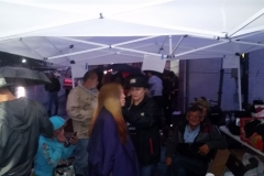 Under the canopies as the homeless line up in the rain at our Thanksgiving event.