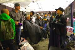 Cutting the homeless hair in the rain in downtown San Diego during Thanksgiving.