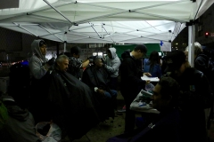 Cutting San Diego's downtown homeless hair in the dark and rain for our Thanksgiving event.