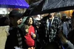 Carlos helps the homeless on Thanksgiving downtown in the rain.