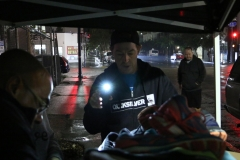 Parker helps size up shoes for the homeless in downtown San Diego.