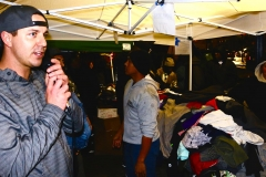 Homeless volunteer David on the mic before passing out clothing donations to the homeless on Thanksgiving.